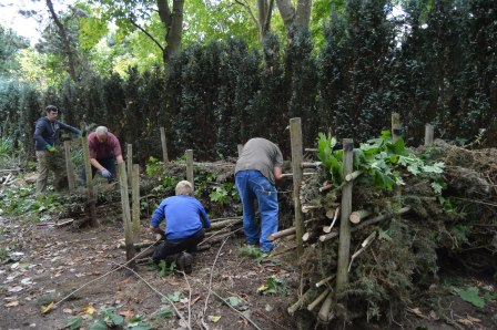 Green Angels trainees building compost bays using waste materials  from the gardens, creating a sustainable future at Liverpool Festival  Garden. Mike Hendricks, Rowan Joyce, Chris Taylor and David  Cundliffe. (The Land Trust)