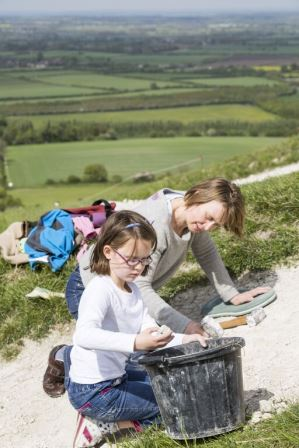 Family Volunteers re-chalking a white horse  ©National Trust Images / James Dobson