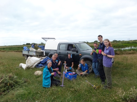 The work party at RSPB Dungeness taking a break from meadow  management (RSPB Dungeness Staff)
