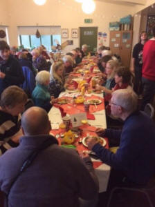 Getting stuck in…the volunteers enjoy  a well-earned Christmas lunch, waited  on by the staff of course!  (Tim Appleton)
