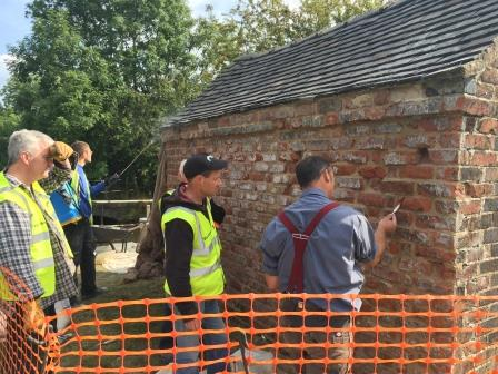 Volunteers learning traditional brickwork techniques on a Caldon Canal  lengthsman's hovel (Canal & River Trust)