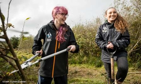 Cat Edwards and Arianne Arnold from the Pembrokeshire Coast National  Park Youth Rangers lend a hand in the Gwaun valley (National Parks UK)