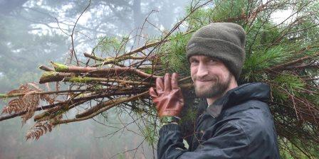 A South Downs National Park volunteer assists with scrub clearance  (National Parks UK)