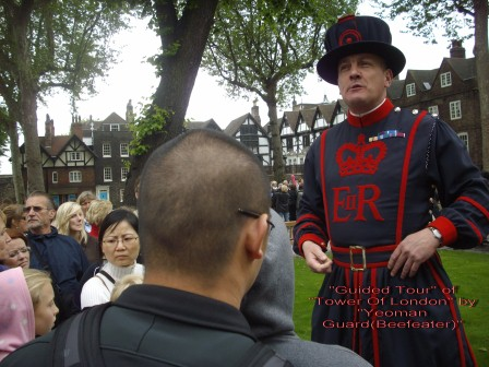 Guide tour of Tower of London by a Yeoman Guard from Wikimedia Commons