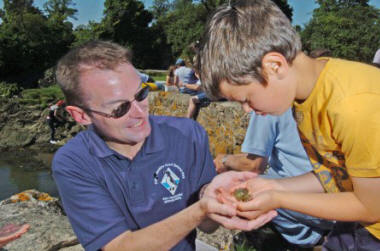 People taking part in a crab catching activity at Carew Tidal Mill. © Pembrokeshire Coast NPA