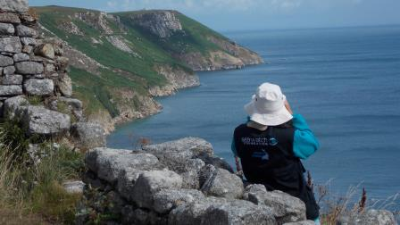 A Sea Watch Volunteer surveys for cetaceans off the Island of Lundy  in the Bristol Channel (Chris Blackmore / Sea Watch Foundation)