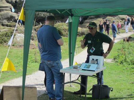 Volunteer selling raffle tickets at the gazebo (National Trust)