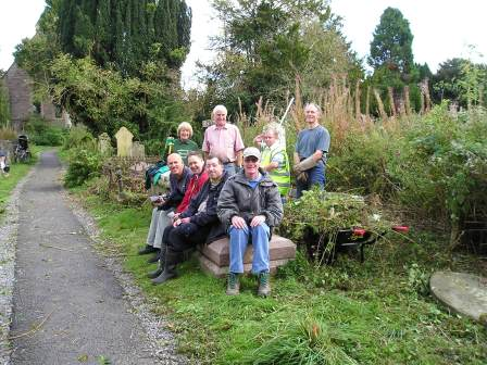 Volunteers clearing willow herb in Leonard's churchyard, Ludlow  (Hilary Smith)