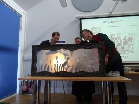 Two Trustees demonstrating shadow puppetry at an away day (Froglife)