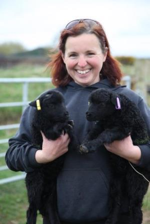 Sian Parry, Conservation Grazing Officer with lambs (Lancashire Wildlife Trust)
