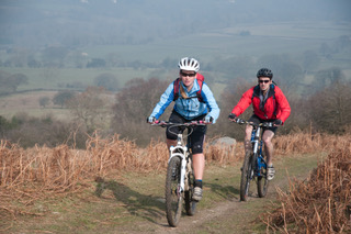 Two people riding mountain bikes in the countryside Copyright Tom Hutton