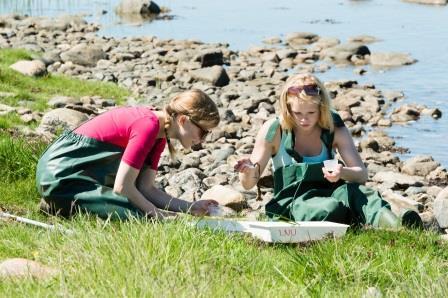 Ecologists sampling the marine environment (Shutterstock)