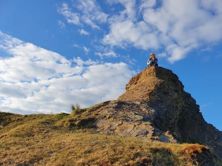 Carys sitting on top of a mountain (Carys Evans)