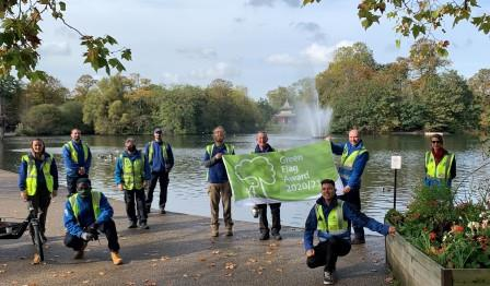People standing with Green Flag banner in Victoria Park London Borough of Tower Hamlets