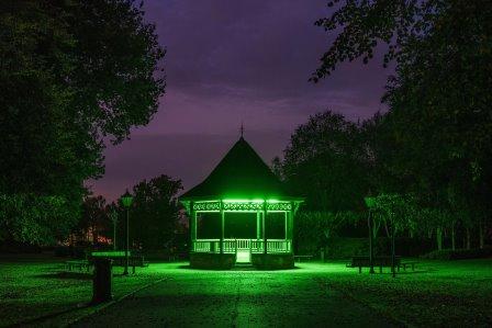 Building lit up at night, Green Flag Award winner Caldecott Park, Rugby Borough Council