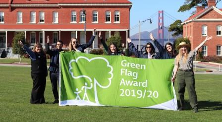People holding a banner in Presidio, San Francisco - First Green Flag Award in USA  - Presidio Trust