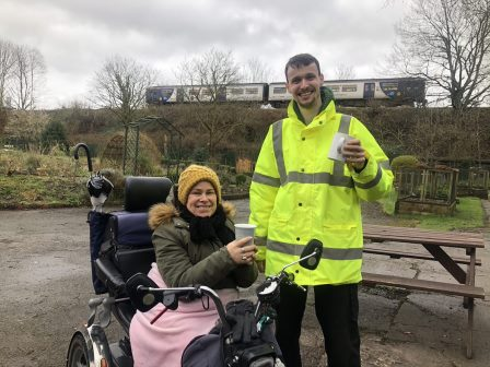 2 people enjoying a cuppa in a community garden (Groundwork)