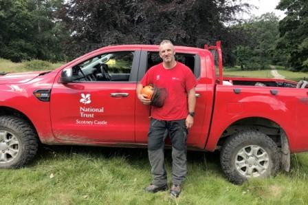 Ray standing by a National Trust pickup (HighGround)