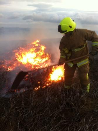 North Yorkshire Firefighter with beater at moor fire (North Yorkshire Fire & Rescue Service)