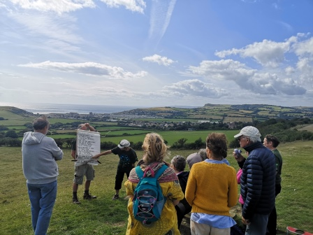 group of people in a field with a Sing and Stroll event © Steph Aburrow