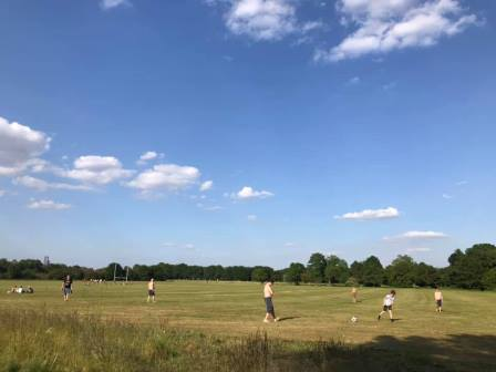 Local people on Turn Moss fields, Trafford, Greater Manchester relaxing and exercising during the Covid-19 pandemic in summer 2020 © Nigel Woodcock