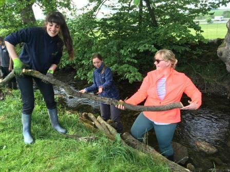 Apprentices clearing wood from a river (Yorkshire Dales Millennium Trust)