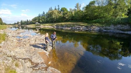 Jamie and a colleague using GIS system in the river (Lantra)