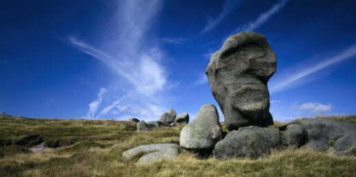 One of the gritstone boulders standing amongst smaller stones on the heath, part of the Kinder Scout Rock formation in the Peak District, Derbyshire. (Image: Joe Cornish/National Trust Images)