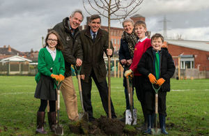 Forestry Minister David Rutley (centre), government Tree Champion Sir William Worsley and Chair of the Woodland Trust Baroness Barbara Young joined students from St Andrews School Radcliffe to plant the first government-funded tree of the Northern Forest. (image: defra)