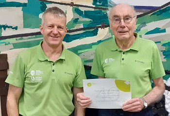 Ranger Neil Hanshaw presented volunteer Geoff Truelove with a certificate marking 40 years' service to the Peak District National Park.(image: Peak District NPA)