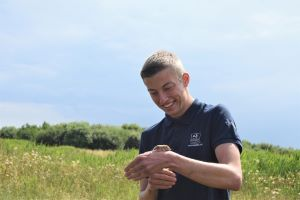 Joel Ireland, Catch My Drift project trainee set to release a water vole at East Chevington. Image by: Sophie Webster.