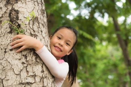child hugging a tree Image: Royal Forestry Society