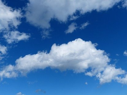 white clouds aginst bright blue sky