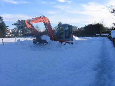 photo: digger moving snow drifts