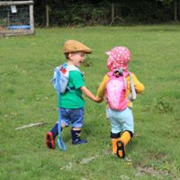 Toddlers holding hands – Orchard Explorers (Countryside Education Trust)