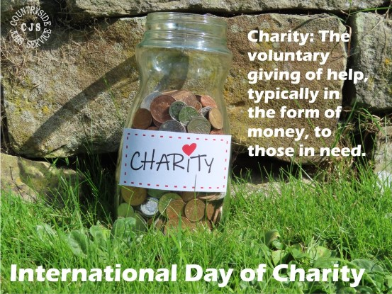 photo of a jar holding coins labeled Charity