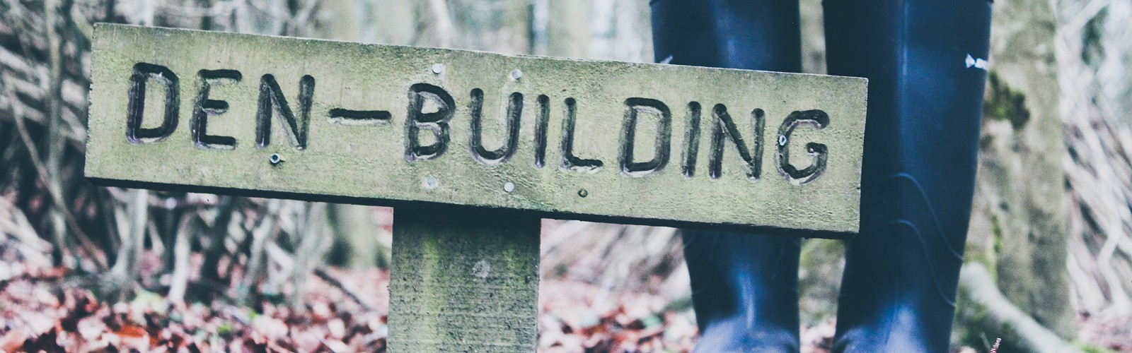 sign that says Den Building (image: Siora Photography on unsplash)