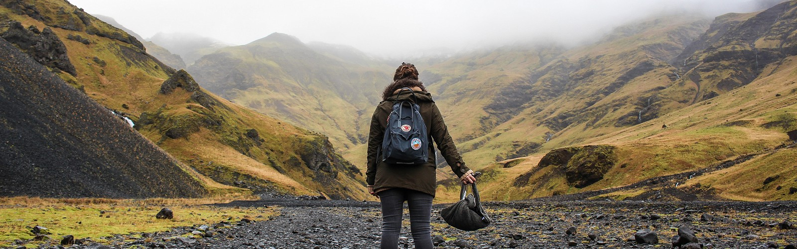back view of person with rucksack standing on stoney track (image: Alexandre Godreau on unsplash)