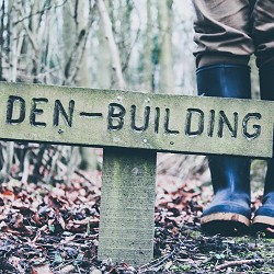 Sign saying den-building (image: Siora Photography on Unsplash)